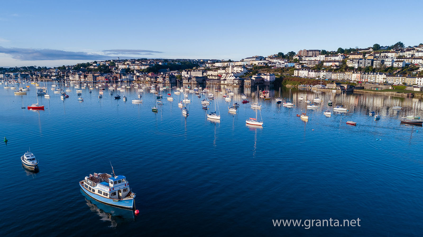 Boats moored up in Falmouth harbour at dawn, summer 2018